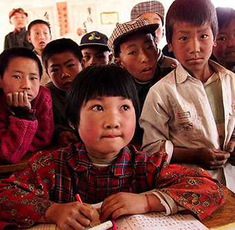 Children gather together in the classroom.