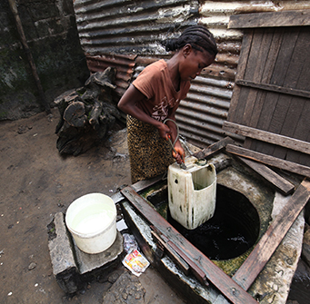 A girl draws water from a well