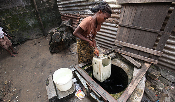 A girl draws water from a well.